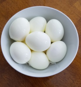 You can peel eggs when still slightly warm for easiest results or leave them in the shell.