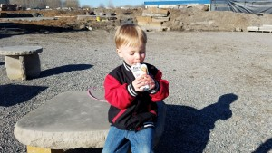 My son enjoying Fuel For Fire while out looking at new landscaping.